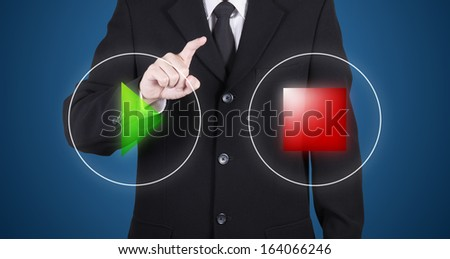 businessman choose between start & stop button, blue background - stock photo