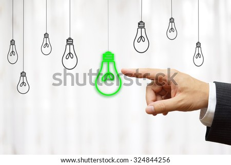 businessman choose green light bulb, idea & environment concept - stock photo