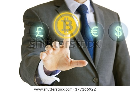 Businessman choosing bitcoin over other currencies on virtual screen isolated on white background - stock photo