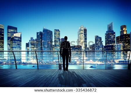 Businessman Cityscape Skyline Night Light Vision Concept - stock photo