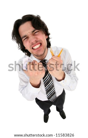 Businessman clenching his teeth in anger - stock photo