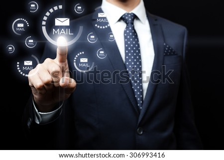 businessman click the button on the screen - stock photo