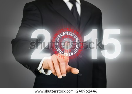 Businessman clicking on 2015 business target - stock photo