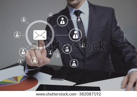 Businessman clicking on email icon. mail service - stock photo