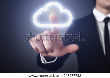 businessman clicks on the touch screen and select the cloud computing. communication. internet concept.