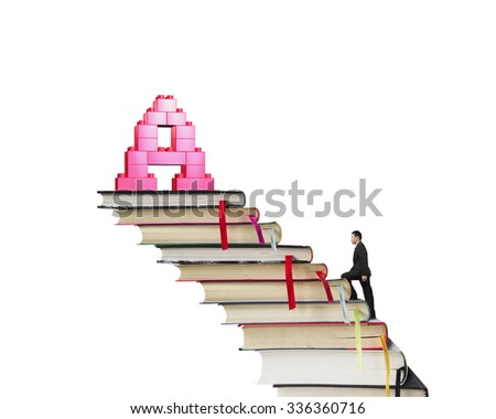 Businessman climbing books stairs toward alphabet letter A shape stack blocks, isolated on white background. - stock photo