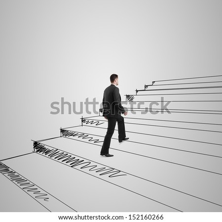 businessman climbing on drawing stairs - stock photo