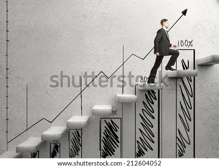 businessman climbing on ladder and drawing  chart - stock photo