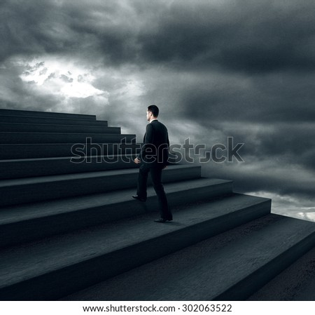 businessman climbing on stairs in bad weather
