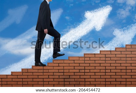 Businessman climbing the brick wall, and follow the rising arrow.