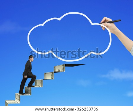 Businessman climbing the money stairs toward white cloud shape with female hand holding pen drawing, on blue sky background, side view. - stock photo