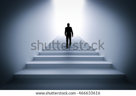 Businessman climbing the stairs towards light. Concept of challenge in life, career etc. 3D illustration