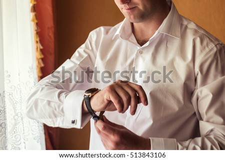 businessman clock clothes, businessman checking time on his wristwatch. men's hand with a watch,the fees of the groom,wedding preparation,preparation for work,fasten clock watch time,man's style