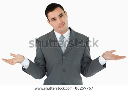 Businessman clueless against a white background - stock photo