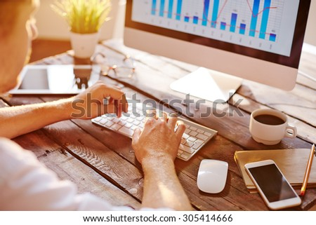 Businessman computing at his workplace - stock photo