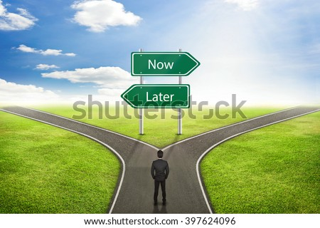 Businessman concept, Sign Now or Later road to the correct way. - stock photo