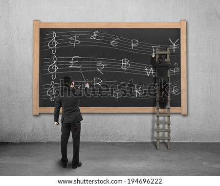 Businessman conducting with another drawing money stave on wooden black board