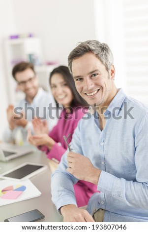 businessman congratulated by colleagues - stock photo