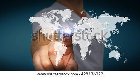 Businessman connecting different places of the world on a screen