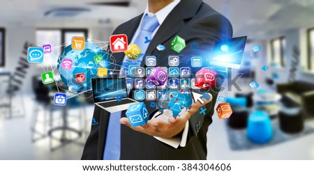 Businessman connecting tech devices and cyberspace applications