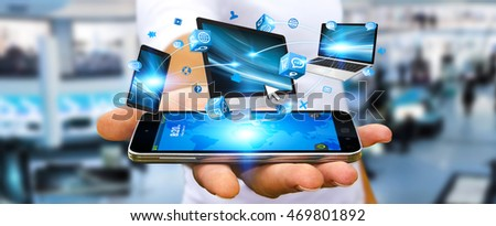 Businessman connecting tech devices computer phone and tablet 3D rendering