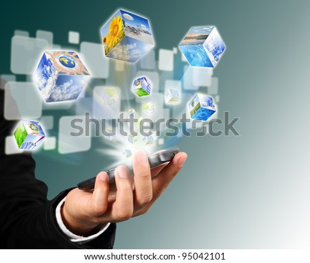 Businessman connection touch screen mobile phone with cubes image flyer - stock photo