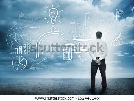 Businessman considering a brainstorm in cloudy desert setting - stock photo