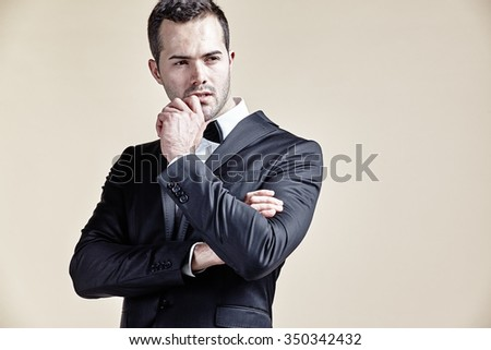 Businessman contemplative isolated - stock photo