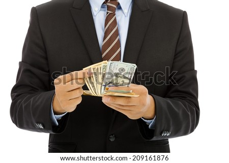 Businessman counting us dollars with white background. Business concept.
