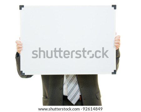 Businessman covered his face with a white board on a white background. - stock photo