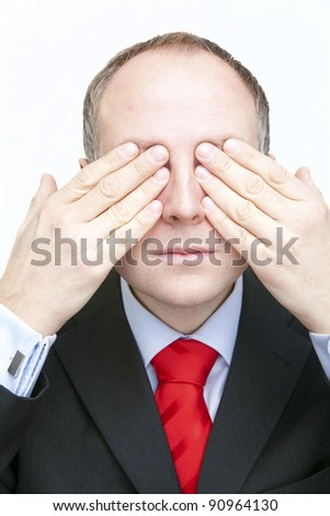 Businessman covering his eyes - stock photo