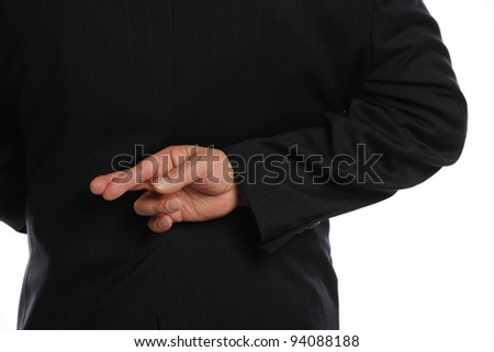 Businessman Crossing Fingers Behind His Back isolated on a white background