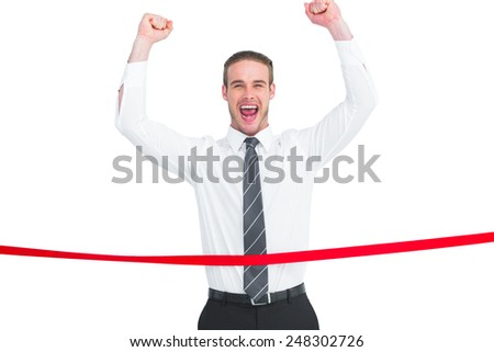Businessman crossing the finish line and cheering on white background