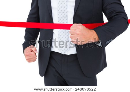 Businessman crossing the finish line on white background - stock photo