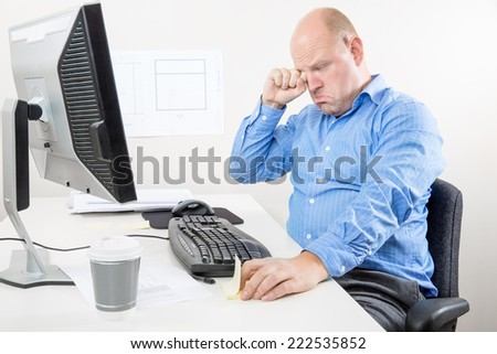 Businessman crying and whining at the office - stock photo