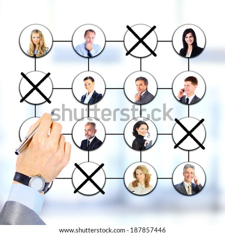 Businessman cutting back jobs. All on white background. - stock photo