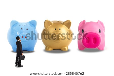 Businessman decision for investment his business with depoit money with three type piggy bank. - stock photo