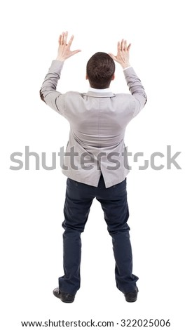 Businessman defends his hands on top of something. backside view of person.  Isolated over white background. - stock photo