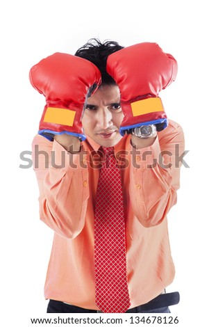 Businessman defense move with boxing gloves on white background - stock photo