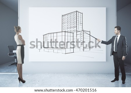 Businessman delivering presentation about architecture to businesswoman in office