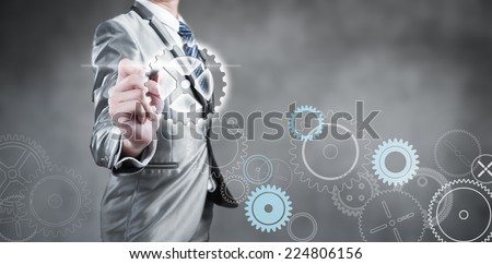 Businessman design gear, business strategy concept - stock photo
