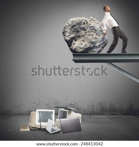 Businessman destroy a technology with a stone - stock photo