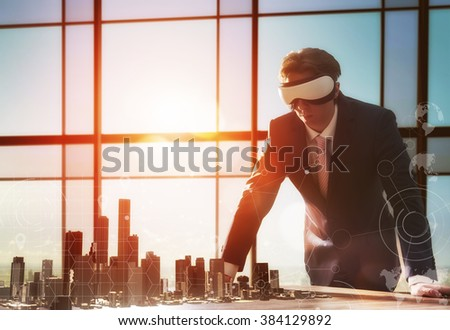 businessman developing a project using virtual reality goggles. the concept of technologies of the future - stock photo