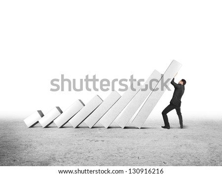 businessman difficult to keep falling columns - stock photo