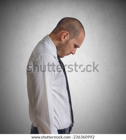 Businessman discouraged and saddened by his failures - stock photo
