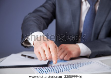 Businessman discussing at work place, dark background
