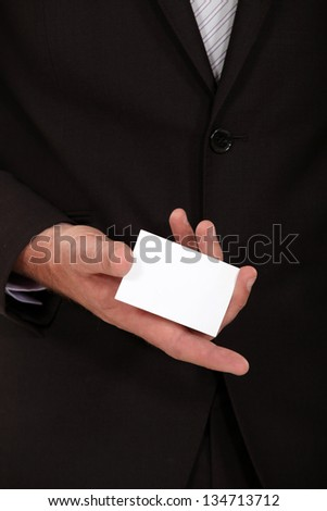 Businessman displaying card