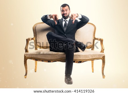 Businessman doing bad signal - stock photo