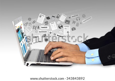 Businessman doing his daily work and social network activity on a laptop computer with internet connection - stock photo