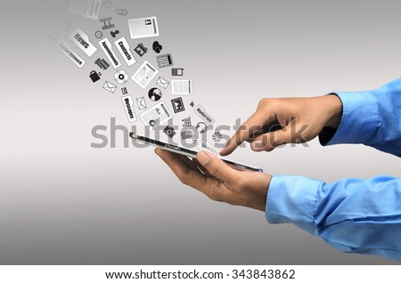 Businessman doing his daily work and social network activity on a smart phone with internet connection - stock photo